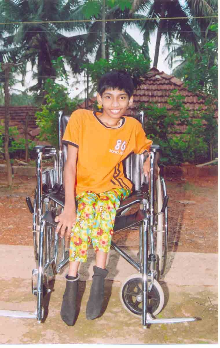 Delighted Neha with new wheelchair